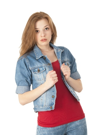 Cute girl in a red T-shirt with jacket  looking and posing for the camera on white background