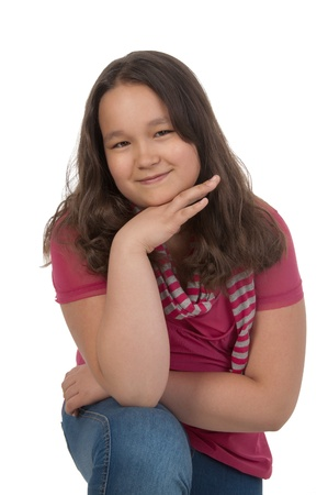 Smiling girl at the age of twelve in pink looking at the camera Stock Photo
