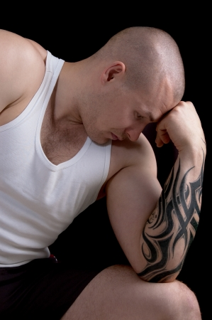 Muscular man with a tattoo on his arm  photo