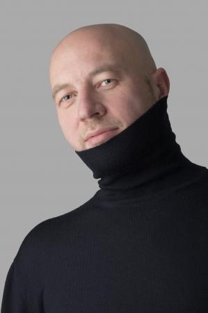 Satisfied bald man looking at the cavera