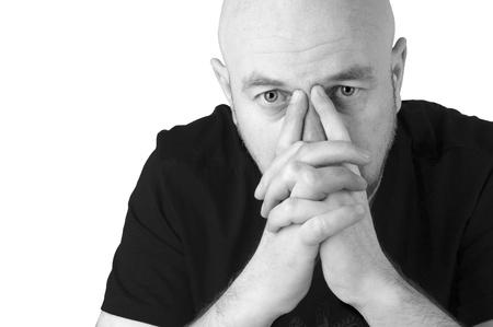 Upset bald man looking at the cavera