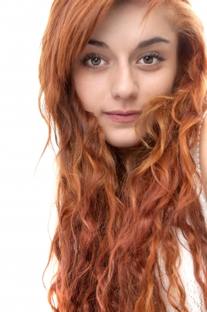 Portrait of a red haired girl of nineteen looking at the camera on white Banco de Imagens