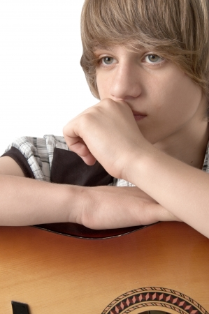 Portrait of Teenage Boy with guitar Looking Relaxed photo