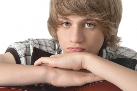 Portrait of Teenage Boy putting his hands on the guitar Looking at the camera photo