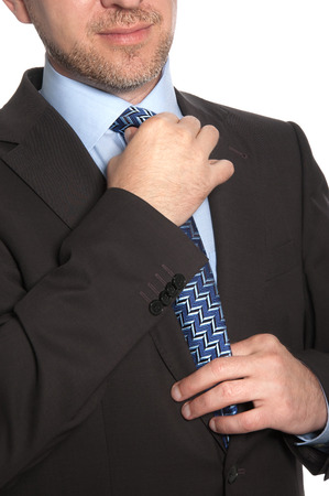 Man in a suit and tie on a white background Stock Photo
