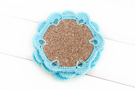 Crochet  blue coaster with cork base