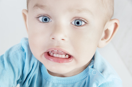 Adorable  little boy at the age of two in a blue T-shirt  looking at the camera Stock Photo