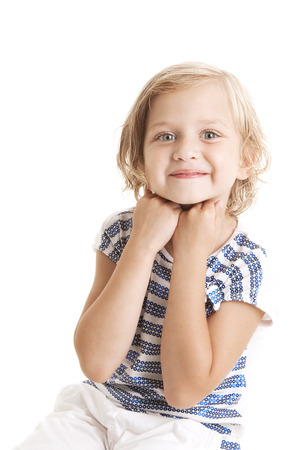 Adorable  little giirl  putting her hands to the face and looking at the camera on white background  photo