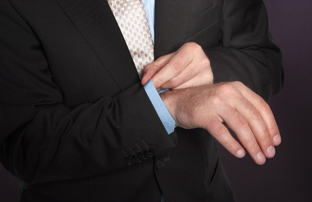 Closeup hands  of a man in suit and tie