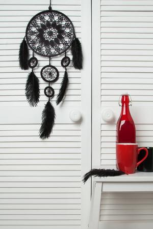 closet door: Black dream catcher in bedroom interior . Bedroom decor
