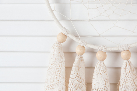 jalousie: Lace cream dream catcher in bedroom interior . Bedroom decor