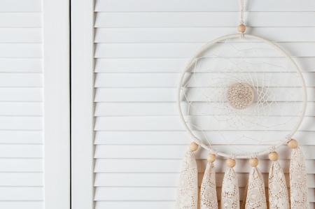closet door: Lace cream dream catcher in bedroom interior . Bedroom decor