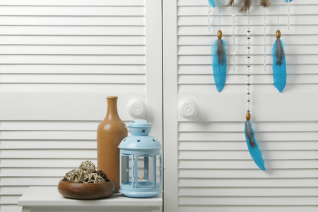 Blue brown bedroom decor with bottle and candlestick on the closet door background