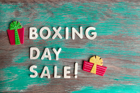 boxing day: Boxing day sale and felt gift boxes on green shabby wooden background