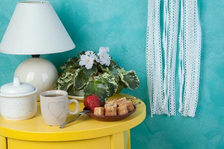 Bedroom decor on aquamarine textured background.Texture of concrete