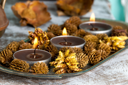 Brown aroma candles in bedroom interior. Bedroom decor. Stock Photo