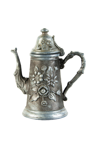 Vintage pewter gray jug with floral ornament isolated on white