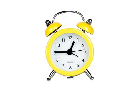 Yellow alarm clock isolated on white background Фото со стока - 94913557