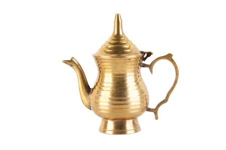 Vintage brass teapot with lid isolated on white background