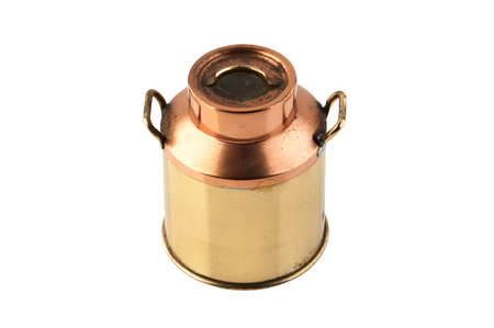 Top view of vintage brass copper can with lid and handles isolated on white background