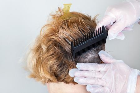 Dark roots of hair, overgrown hair. Hair dyeing 版權商用圖片