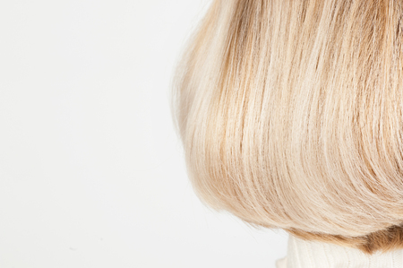 Blonde female hairstyle close up on white Imagens