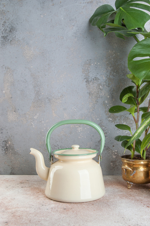 Vintage enamelled kettle on concrete background. Copy space for text. Zdjęcie Seryjne