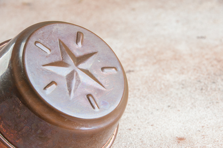 Vintage copper cookie molds on a concrete background. Copy space for text. 版權商用圖片