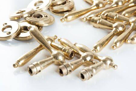 Set of vintage brass door handles on white background. Copy space for text.