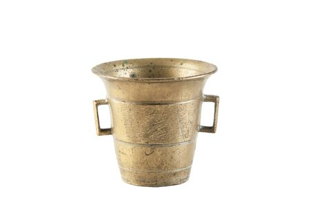 Vintage brass mortar isolated on white background