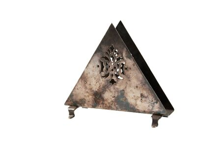 Antique metal napkin holder isolated on white background. Food photography props