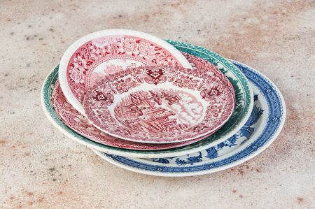 Antique porcelain dishes close up on concrete background. Copy space for text, food photography props.
