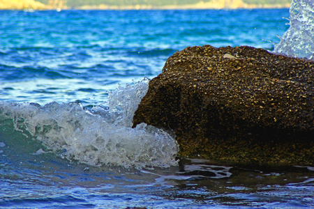 Waves splash into the rocks