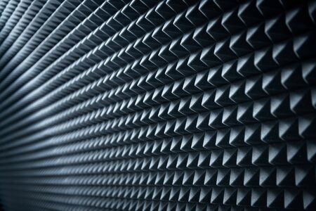 Grey dampening acoustic foam in the vocal recording room.