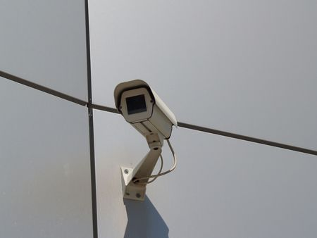 Camcorder of security system supervising territory. Front view. Stock Photo