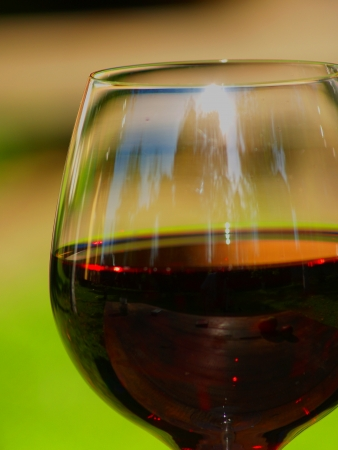 Crystal glass of wine. Green background.