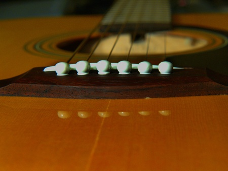 Musical instrument. Guitar. Six string. Finger-board. Yellow and dark brown.