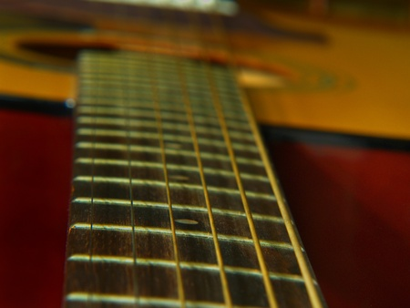 Musical instrument. Finger-board of guitar. Six strings.
