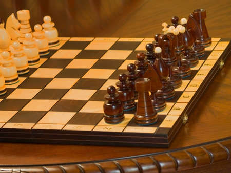 Black and white piece on the chess-board. Pawns before start. Stock Photo