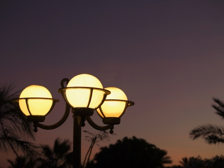 Lamps in the tropic park  Sunset time  Res sea  Stock Photo