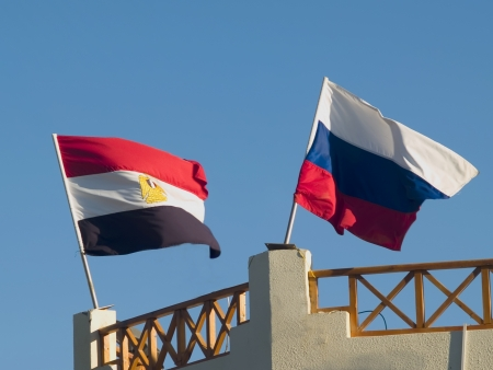 Flafs on the roof. Russia and Egypt on sky background. Stock Photo