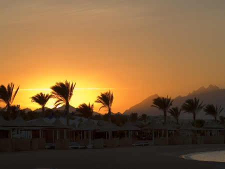 Sunset on Red sea. Empty beach after hot day on Coral beach.