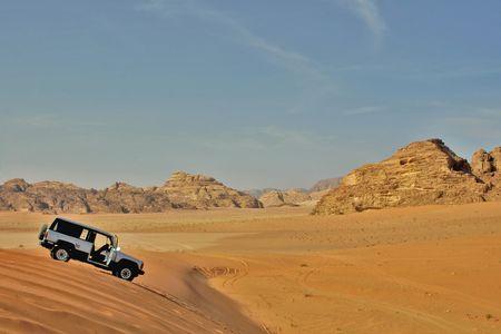 white jeep car in rocky desert