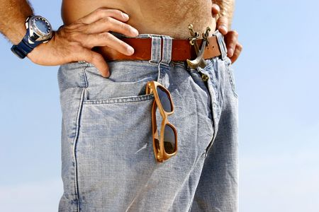 close up of a young man in jeans photo