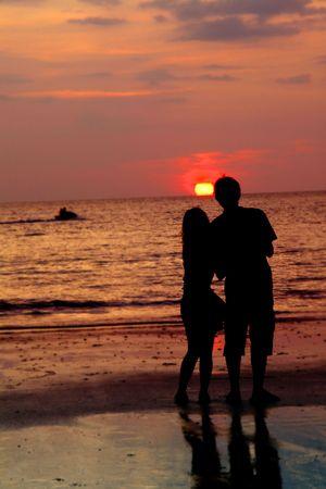 loving couple at sunset photo