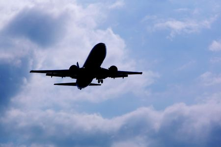 airplane silhouette over sky background Stock Photo - 713209
