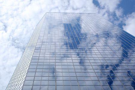 modern office building reflecting sky photo