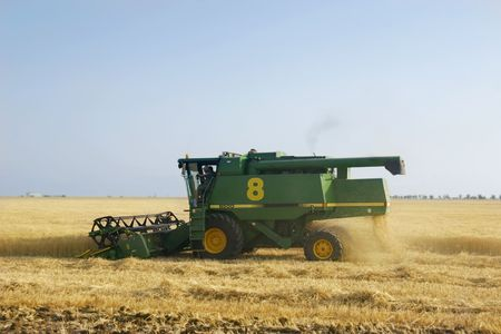 deere: combine on wheat field
