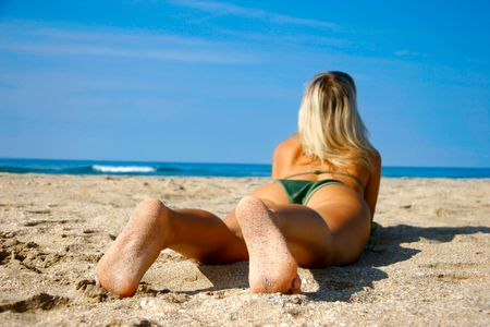 young girl on beach, focus on her feet Stock Photo - 1826535