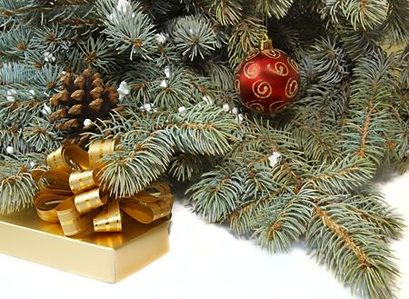 xmas tree, present box and red ball over white photo